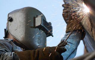 a metal welder busy at work